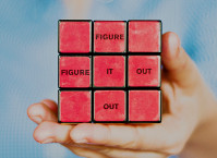 A rubik's cube that reads: figure it out